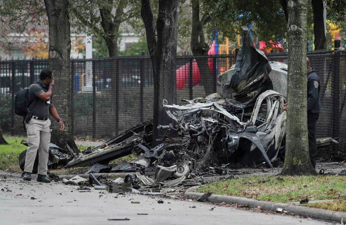 Authorities investigate the scene of a fatal crash alongside Southmayd Elementary School, near the intersection of Coral and Kernel on Jan. 22, 2021, in Houston. A fleeing car theft suspect sped through the neighborhood to evade police.