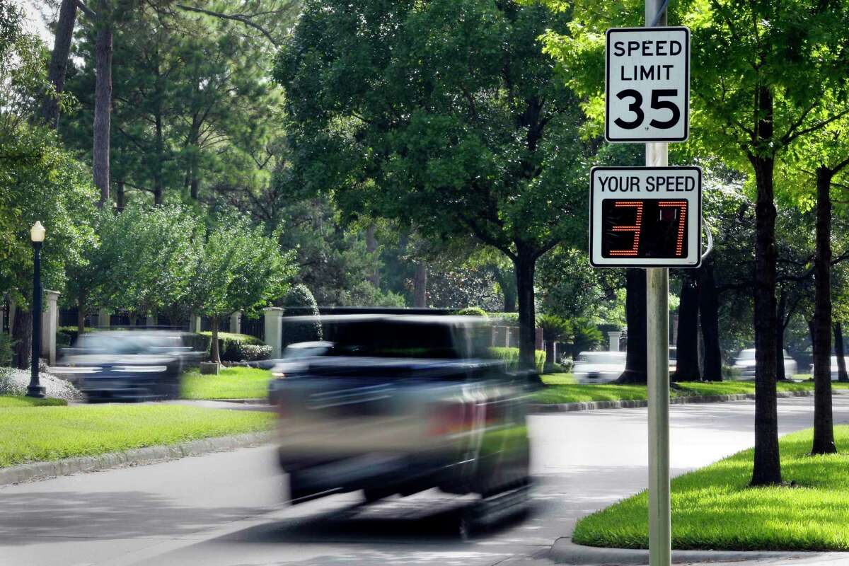 Traffic moves westbound past a speed warning sign in River Oaks along Kirby, just west of Shepherd on July 3, 2020 in Houston. Speeds on some neighborhood streets in Texas, but not major thoroughfares such as Shepherd, would be lowered under a proposal under consideration in Austin.