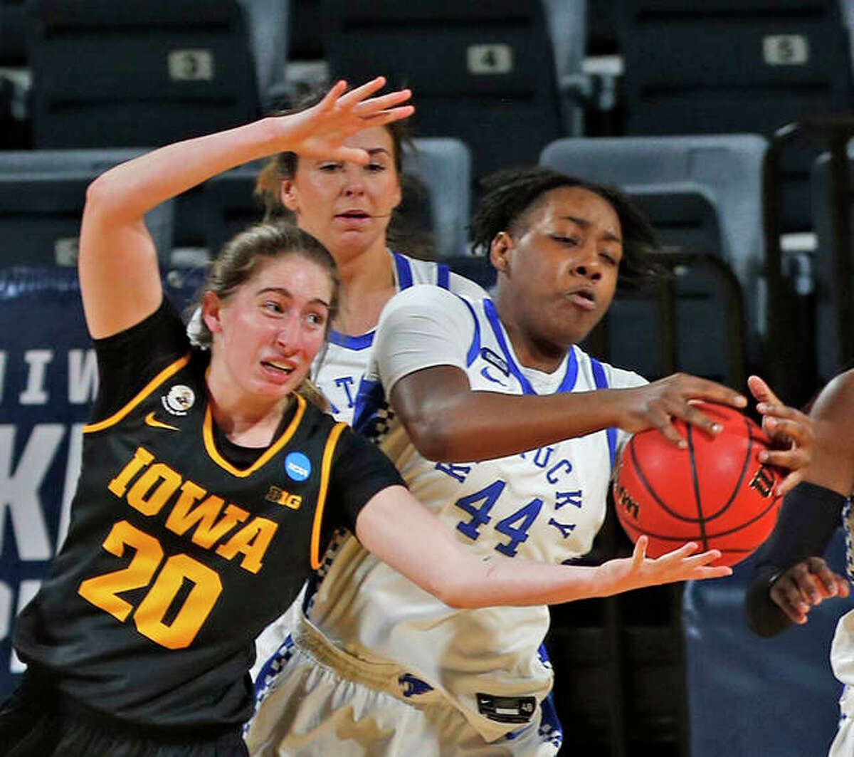 Iowa guard Kate Martin (20) battles Kentucky guard Dre'una Edwards (44) for a rebound during the first half of a college basketball game in the second round of the women's NCAA tournament at the Greehey Arena in San Antonio, Texas, Tuesday, March 23, 2021.