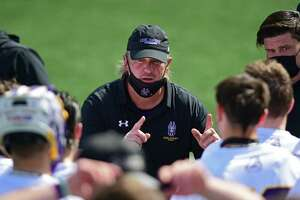 University at Albany men's lacrosse coach Scott Marr talks to his player during a lacrosse game against University at Massachusetts on Tuesday, March 23, 2021 in Albany, N.Y. (Lori Van Buren/Times Union)