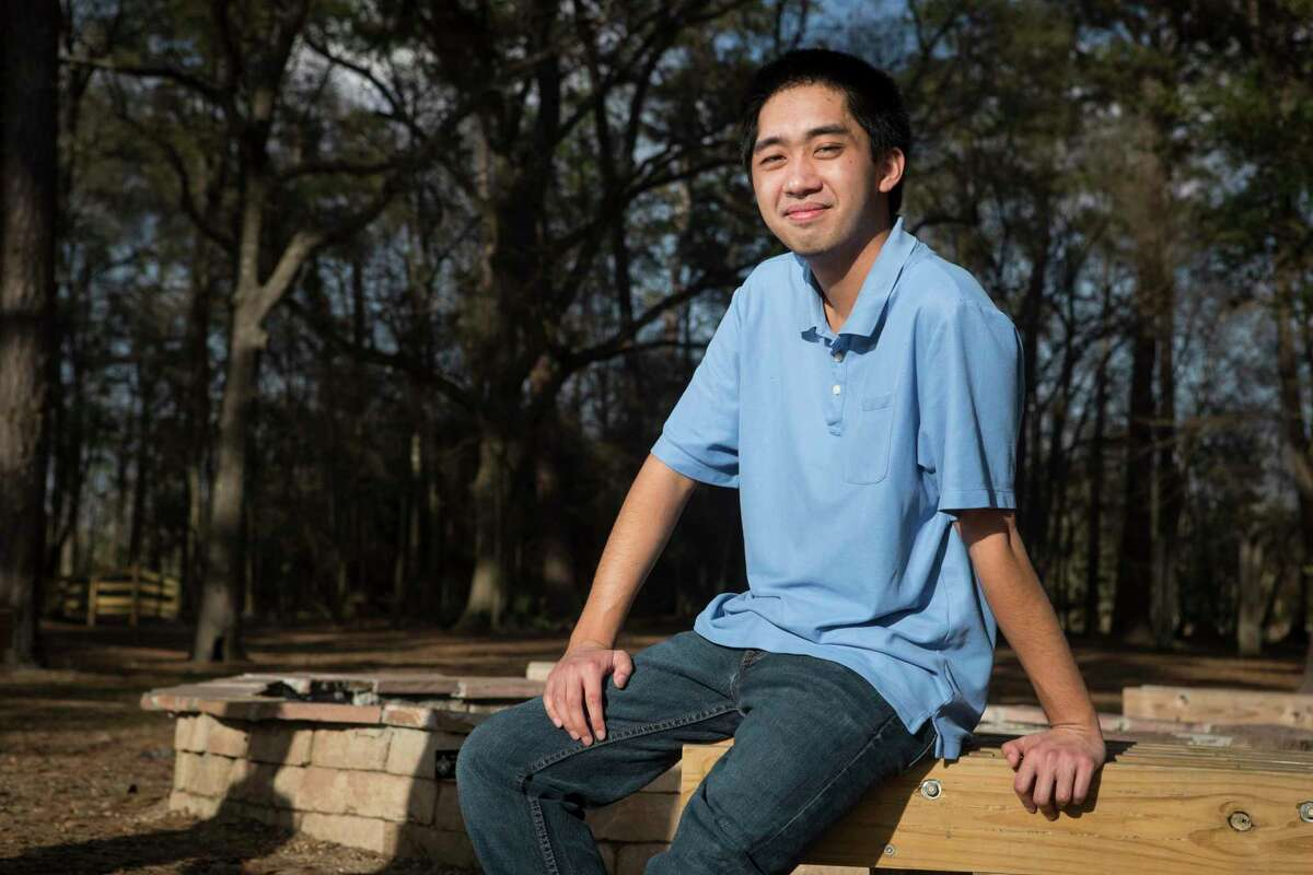 University of Texas student Francis King poses for a portrait at Kickerillo-Mischer Preserve Friday, March 12, 2021 in Houston. King is in his first year at UT Austin, but because of COVID-19 has been stuck studying at home. When he finished his finals before Christmas break, he developed a terrible headache and called 911, a CT scan revealed that his brain was hemorrhaging and he was life flighted to Memorial Hermann for a life-threatening condition. By the time he arrived, he had already slipped into a coma. A couple of surgeries later, King has now recovered and is back to school work.