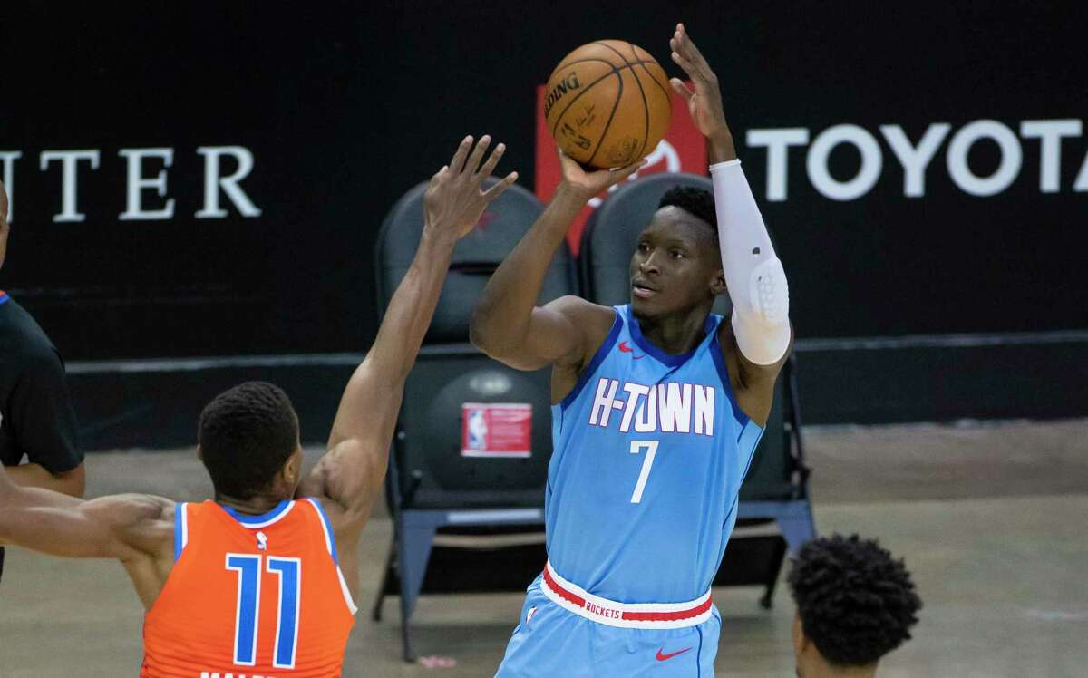 Houston Rockets guard Victor Oladipo (7) shoots a three point shot over Oklahoma City Thunder guard Theo Maledon (11) during the fourth quarter of an NBA game between the Houston Rockets and Oklahoma City Thunder on Sunday, March 21, 2021, at Toyota Center in Houston, TX.