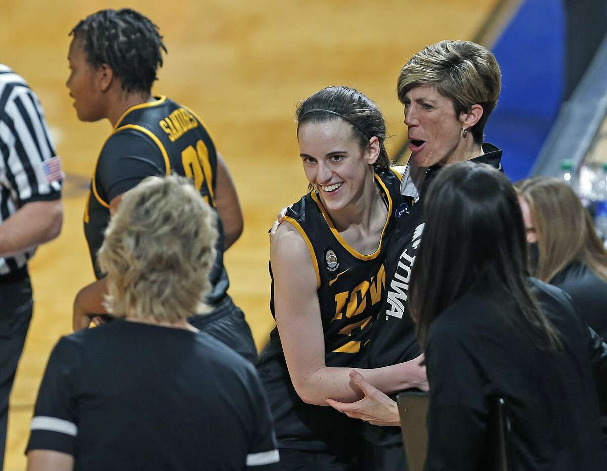 Iowa assistant coach Jen Jensen hugs guard Caitlin Clark during the closing minute of the Hawkeyes' win over Kentucky.