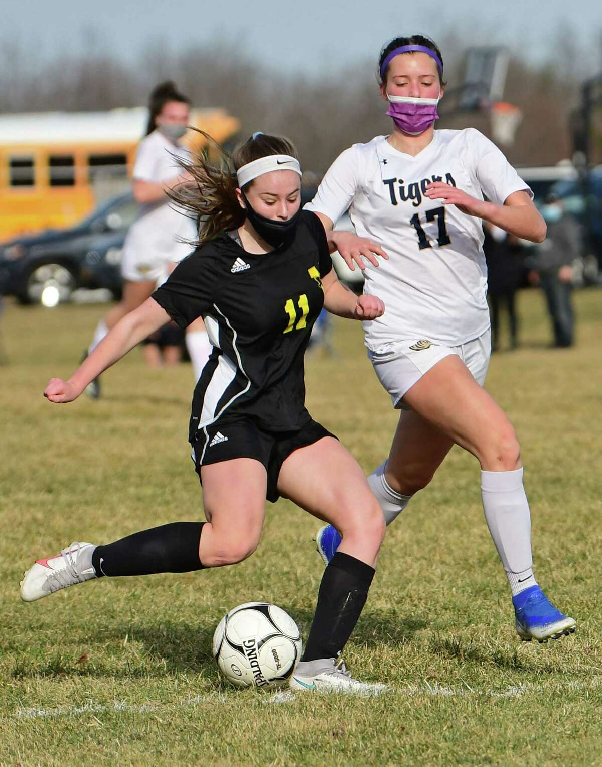 Voorheesville's Emma Farrell is defended by Cohoes' Carissa Shanahan during a soccer game on March 23, 2021. She is looking forward to her senior season with the Blackbirds.