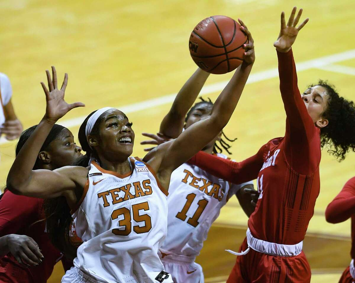 Charli Collier of Tex, grabbing a rebound against Bradley in the NCAA Tournament, was glad to get her first postseason win as a Longhorn.
