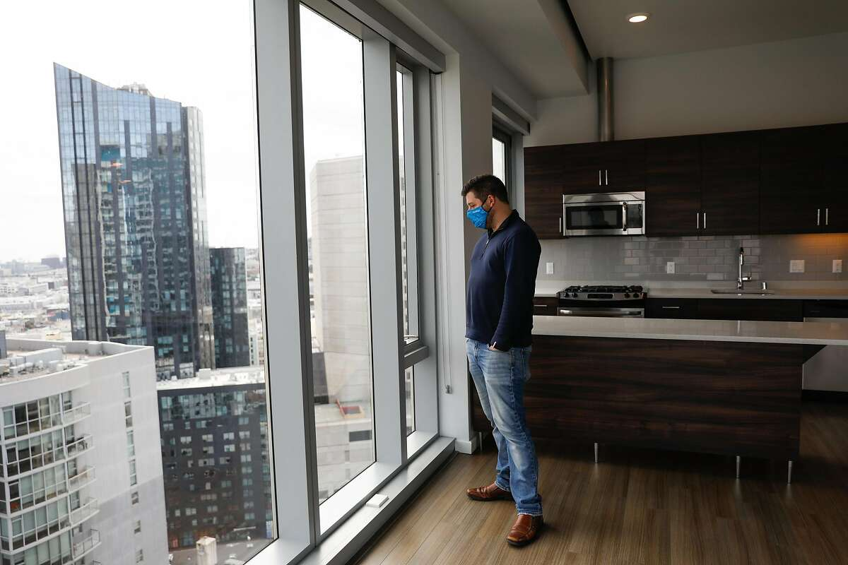 Manager Justin Sielbach gives a tour of a unit at the 100 Van Ness apartment building in San Francisco.