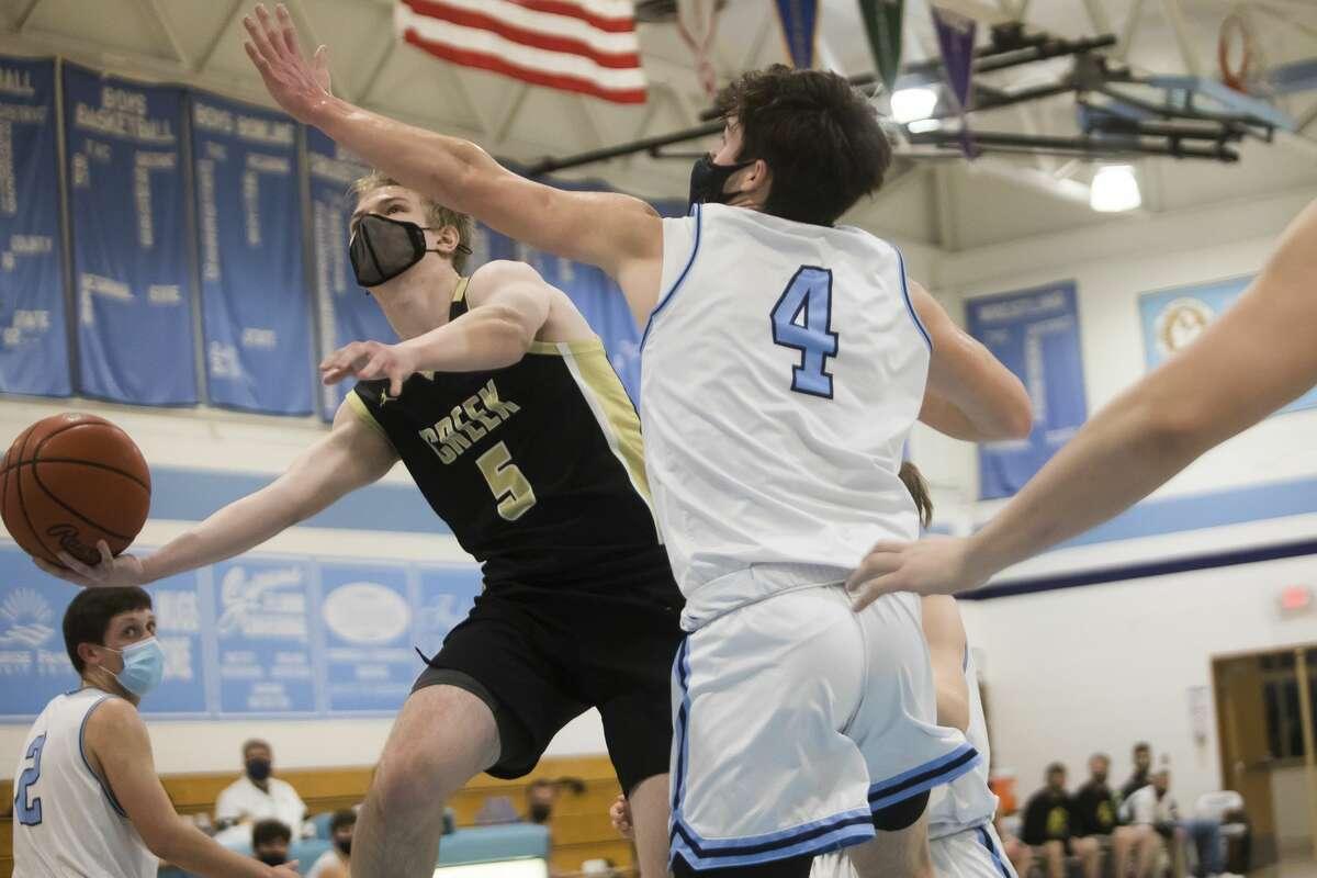 Bullock Creek's Hayden Farquharson takes a shot during the Lancers' district quarterfinal against Garber Tuesday, March 23, 2021 at Garber High School. (Katy Kildee/kkildee@mdn.net)