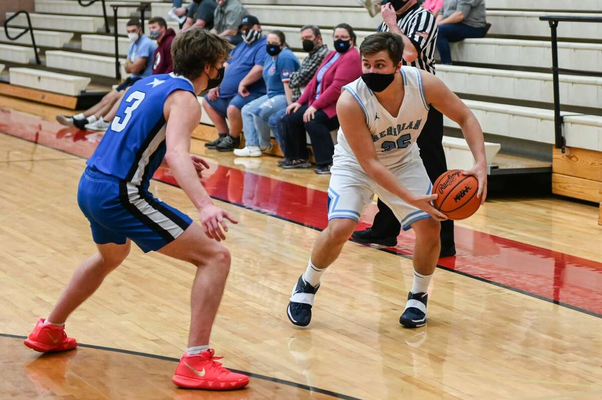 Meridian's Josh Barriger trys to move past a defender during the Mustangs' district quarterfinal game against Beal City Tuesday, March 23, 2021 at Beaverton High School. (Adam Ferman/for the Daily News)
