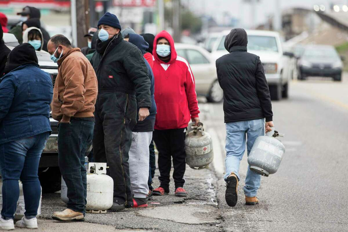 People line up to fill empty propane tanks at a business on the North Freeway Tuesday, Feb. 16, 2021 in Houston.