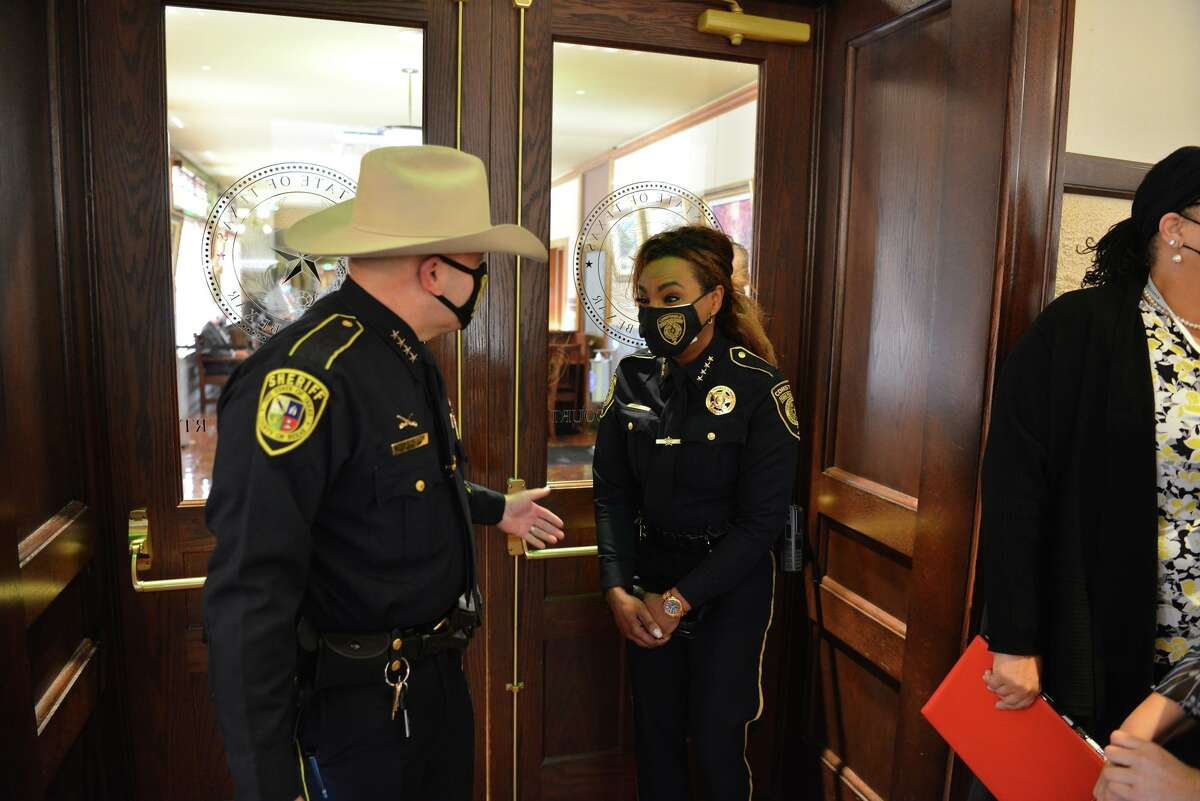 Bexar County sheriff Javier Salazar talks with Precinct 4 Constable Kathryn Brown during Tuesday's meeting of the Bexar County Commissioners.