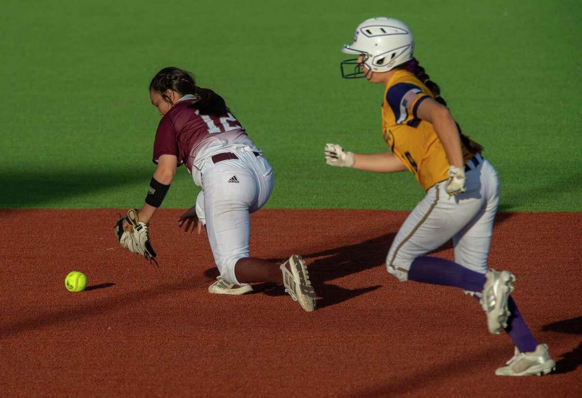 Lee High's Jaycie Pacheco fields a hit as Midland High's Jolie Baeza runs to third 03/23/21 at Martin Field. Tim Fischer/Reporter-Telegram