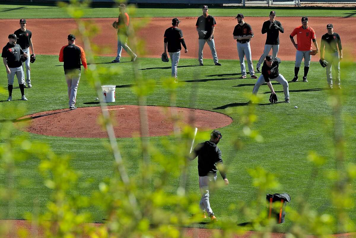 Fielding exercise for pitchers as the San Francisco Giants worked out at Scottsdale Stadium in Scottsdale, Ariz., on Monday, March 1, 2021.