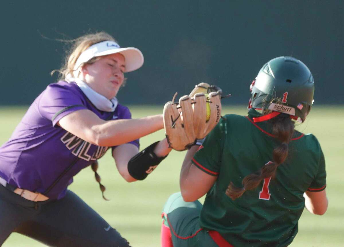 Willis shortstop Lainey Niederhofer (5) tags out Alannah Leach #1 of The Woodlands during the first inning of a District 13-6A high school softball game at Willis High School, Tuesday, March 23, 2021, in Willis. Niederhofer was injured on the play and did not return.