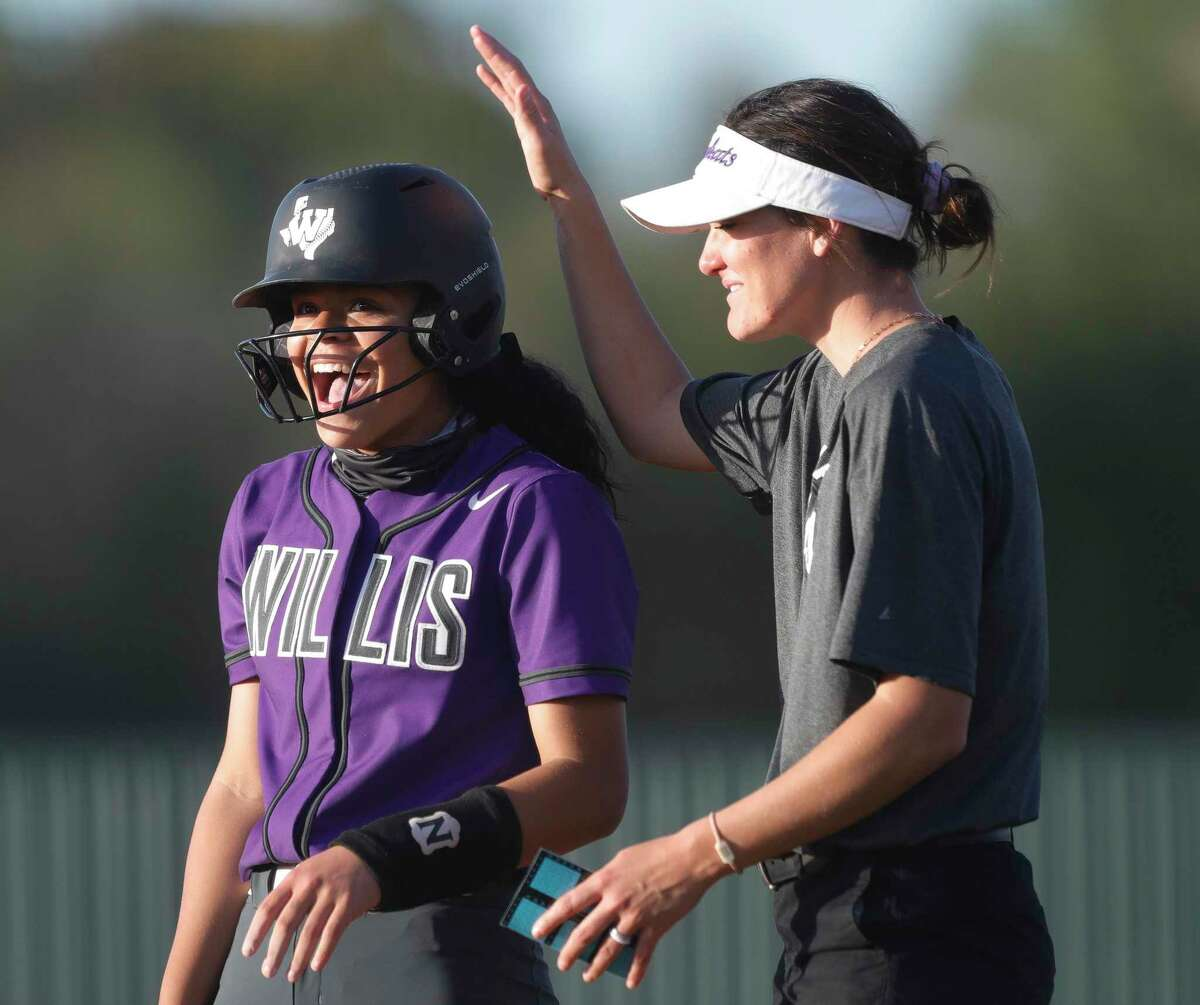 Madelyn Macaluso #12 of Willis reacts after hitting an RBI single during the first inning of a District 13-6A high school softball game at Willis High School, Tuesday, March 23, 2021, in Willis