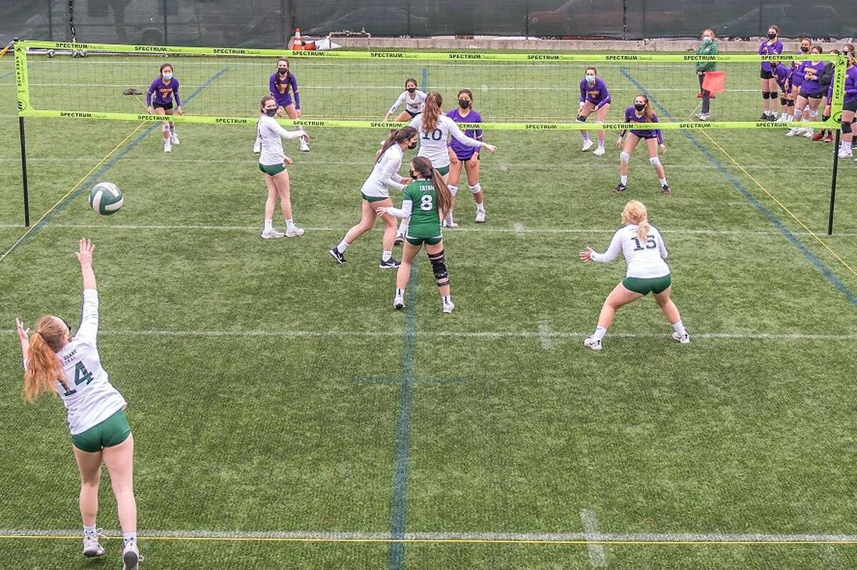 After being led out by Sacred Heart Cathedral junior setter and bagpiper Maura Baglin, the Irish and visiting Riordan played the abbreviated volleyball season's final match on the outdoor court.