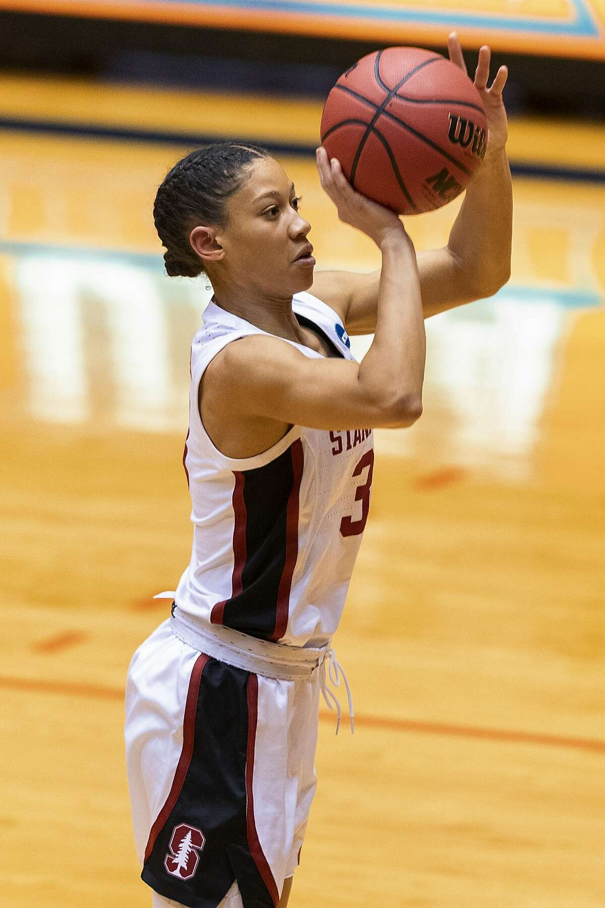 Stanford guard Anna Wilson hits a 3-pointer against Oklahoma State during the first half of a college basketball game in the second round of the NCAA women's tournament at the UTSA Convocation Center in San Antonio on Tuesday, March 23, 2021. (AP Photo/Stephen Spillman)