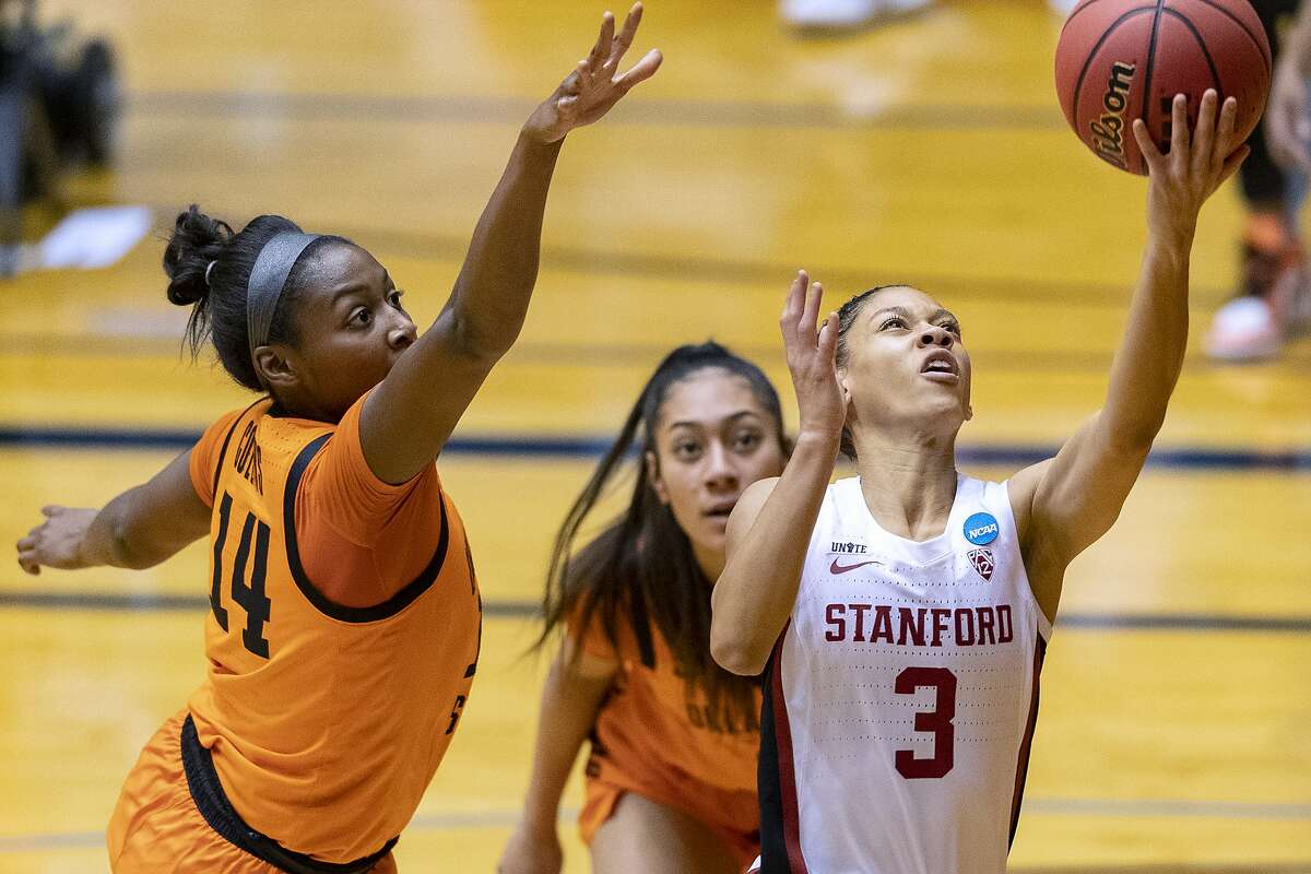 Stanford guard Anna Wilson (3) scores past Oklahoma State forward Taylen Collins (14) during the first half of a college basketball game in the second round of the NCAA women's tournament at the UTSA Convocation Center in San Antonio on Tuesday, March 23, 2021. (AP Photo/Stephen Spillman)