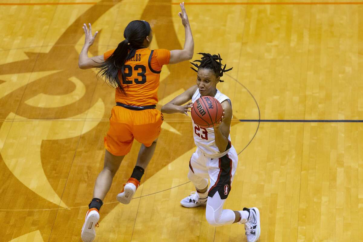 Stanford guard Kiana Williams, right, shoots next to Oklahoma State guard Lauren Fields during the first half of a college basketball game in the second round of the NCAA women's tournament at the UTSA Convocation Center in San Antonio on Tuesday, March 23, 2021. (AP Photo/Stephen Spillman)