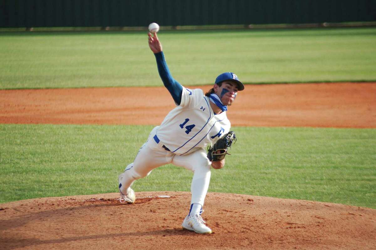 Friendswood's Jacob Rogers (14) pitches against Baytown Sterling Tuesday at Friendswood High School.