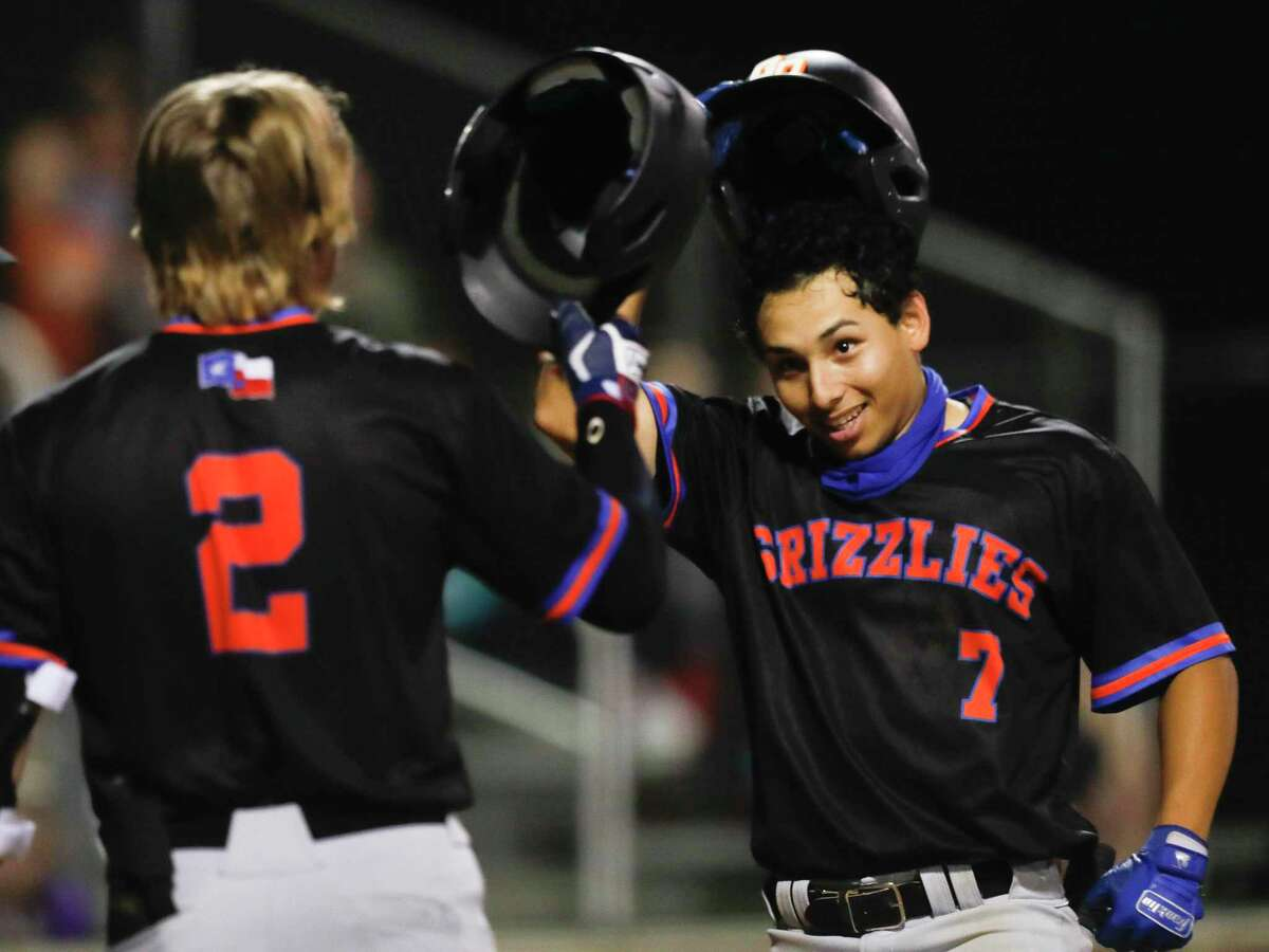 Antonio Sabala #7 of Grand Oaks smiles after hitting a two-run home run during the fourth inning of a District 13-6A high school baseball game, Tuesday, March 23, 2021, in Willis