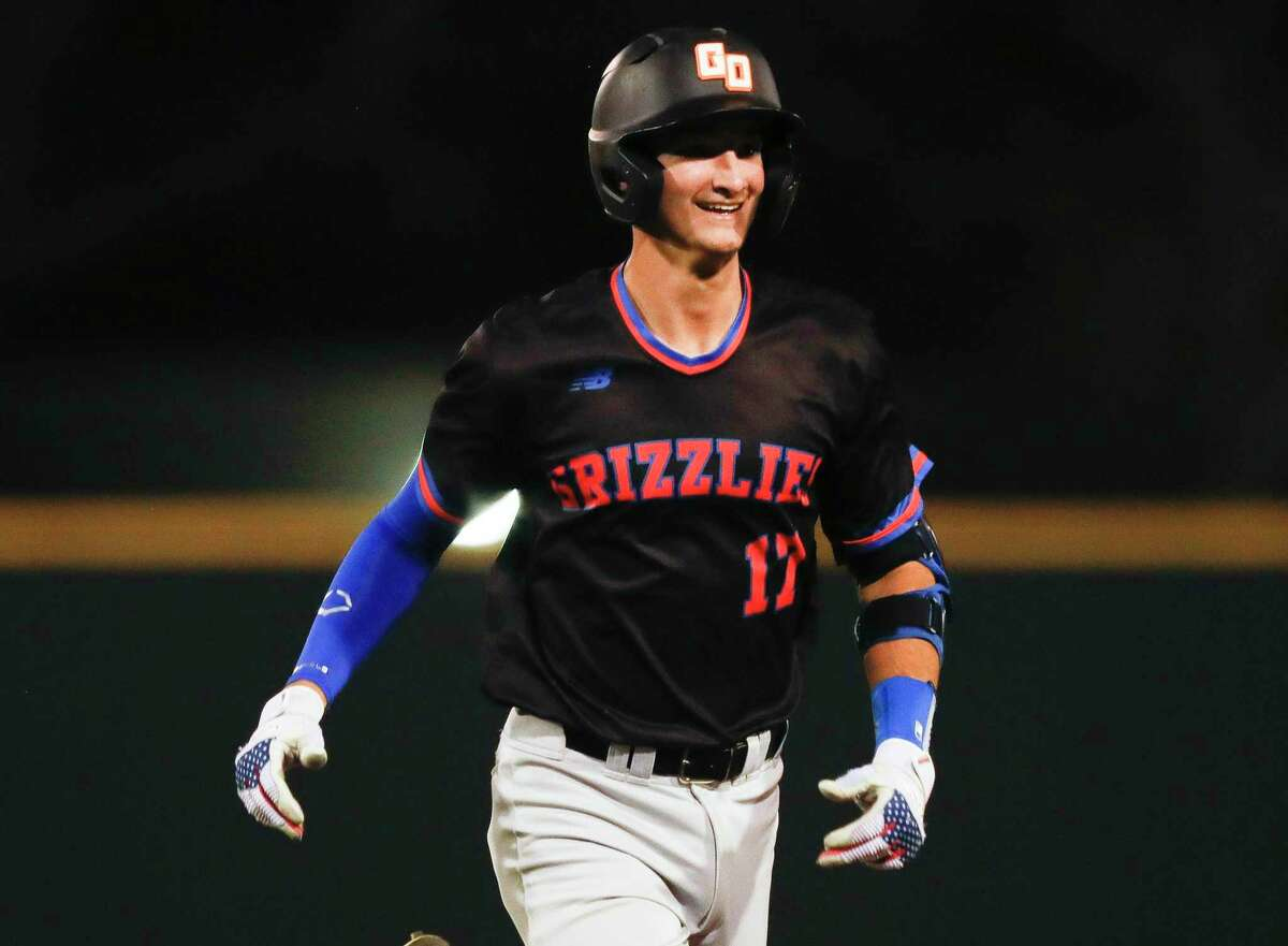 Preston Havenor #17 of Grand Oaks smiles after hitting a double during the fourth inning of a District 13-6A high school baseball game, Tuesday, March 23, 2021, in Willis