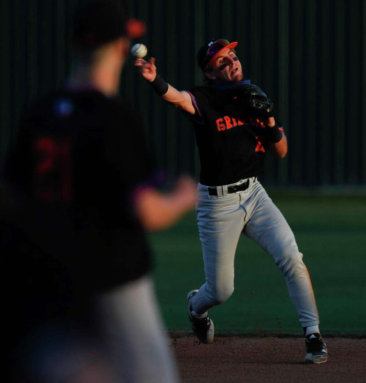 Grand Oaks second baseman Jace Farnsworth (18) throws out #7 of Willis during the second inning of a District 13-6A high school baseball game, Tuesday, March 23, 2021, in Willis