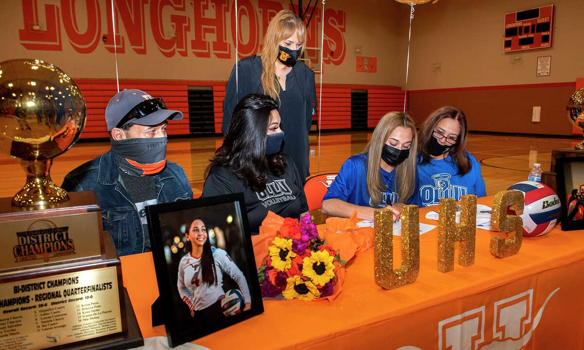 United's Tina Trevino, fourth from left, is joined by her father Roberto Trevino, sister Daniela Trevino, United head coach Lety Longoria and mother Belinda Trevino as she signs her National Letter of Intent to play for Our Lady of the Lake University on Tuesday, March 23 at the United High School gym.
