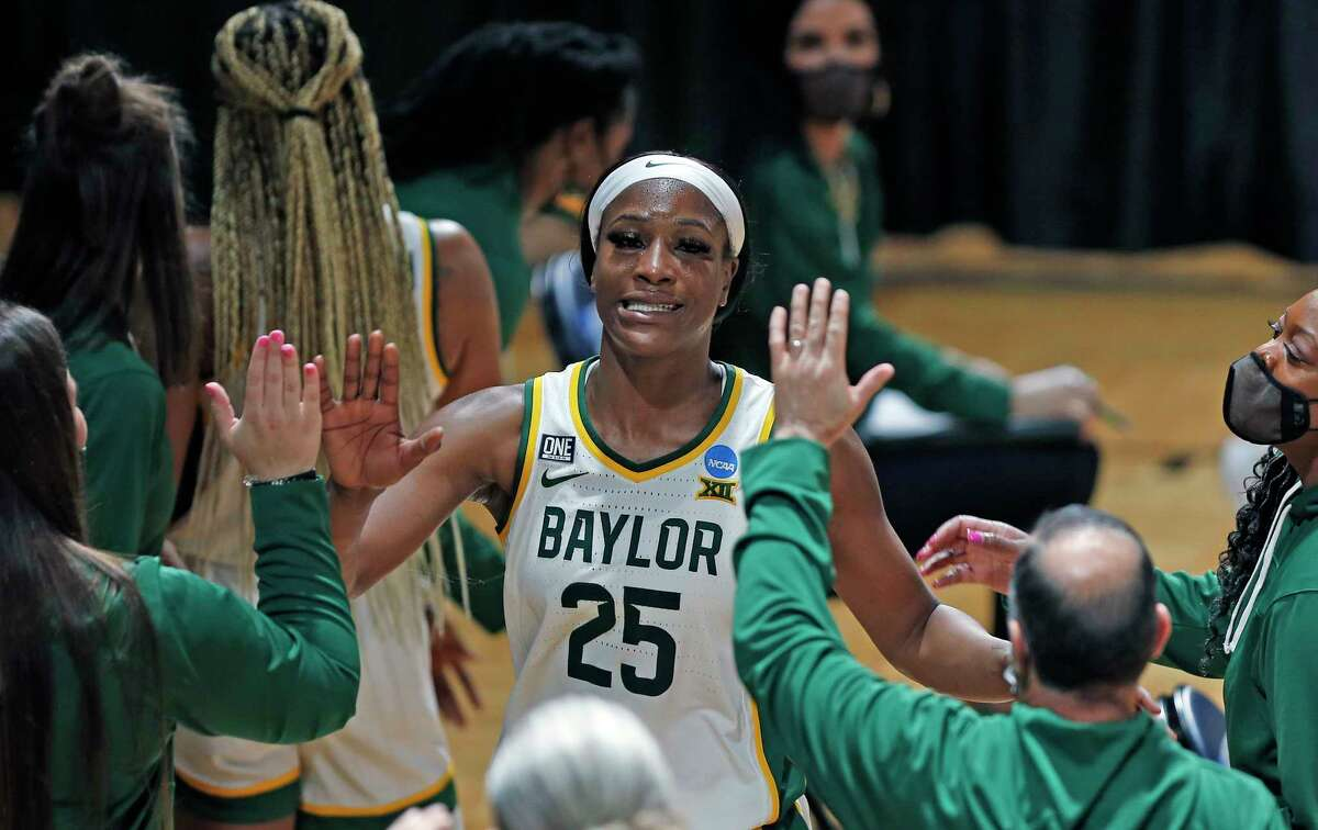 Baylor center Queen Egbo (25) is congratulated as she came to the bench during the second half of a college basketball game against Virginia Tech in the second round of the women's NCAA tournament at the Greehey Arena in San Antonio on Tuesday, March 23, 2021. (AP Photo/Ronald Cortes)