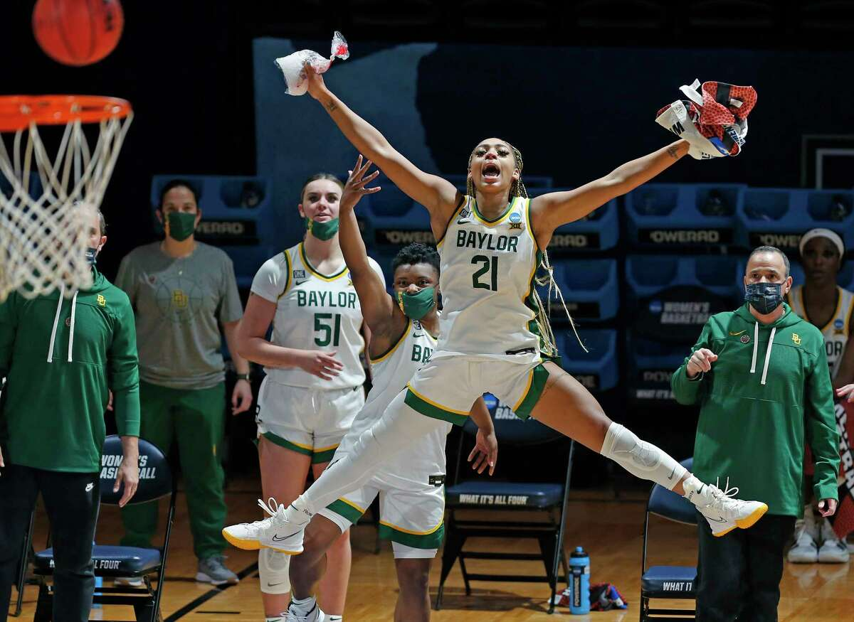 Baylor guard Dijonai Carrington (21) celebrates after the last shot of a college basketball game against Virginia Tech in the second round of the women's NCAA tournament at the Greehey Arena in San Antonio, Tuesday, March 23, 2021. (AP Photo/Ronald Cortes)