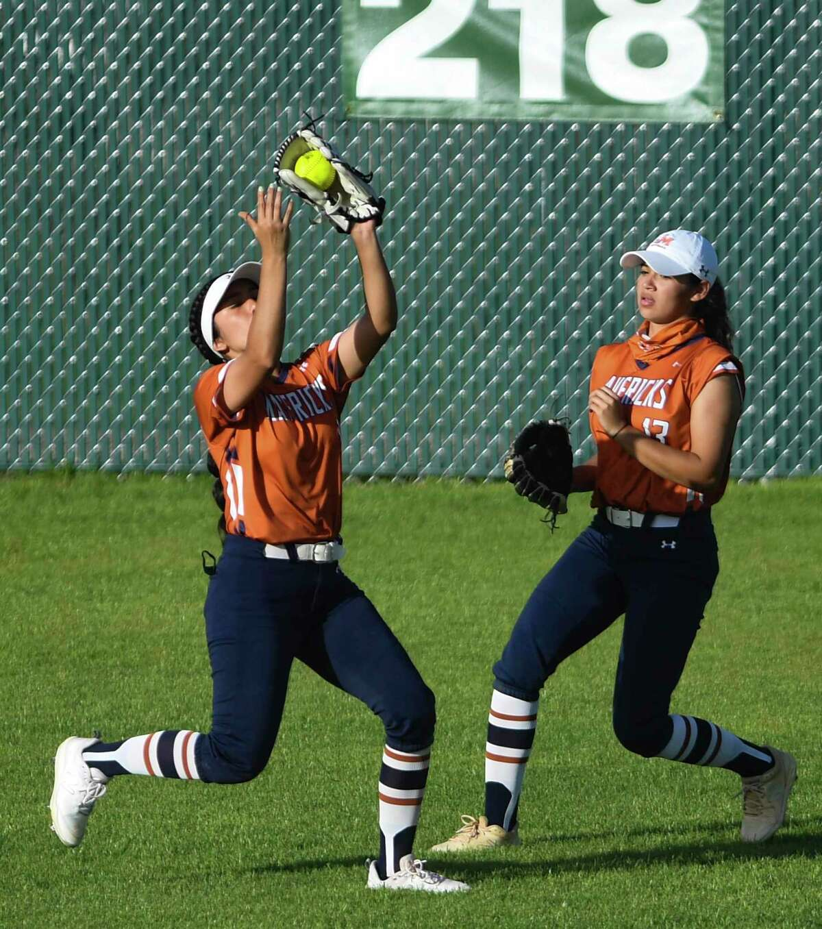 Madison centerfielder Samantha Ytuarte catches a long fly ball as Vejeigh Zamora looks on during softball action against Brandeis at the Northside Athletic Complex on Tuesday, March 23, 2021. Brandeis won the game, 9-5.