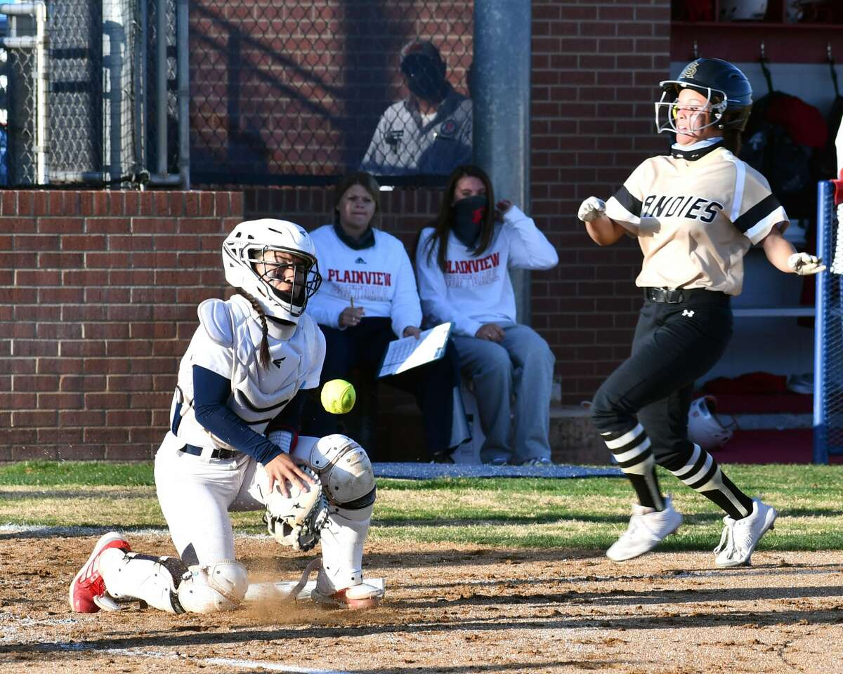 Plainview catcherAaleah Rodriguez tries to corral the ball to stop the Amarillo player from scoring during their District 3-5A softball game on Tuesday at Lady Bulldog Park.
