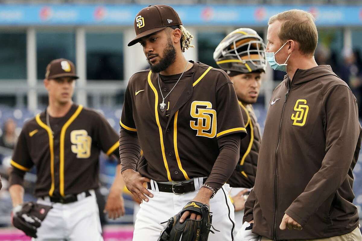 Padres shortstop Fernando Tatis Jr. leaves the field following an injury to his shoulder Tuesday in a spring training game.