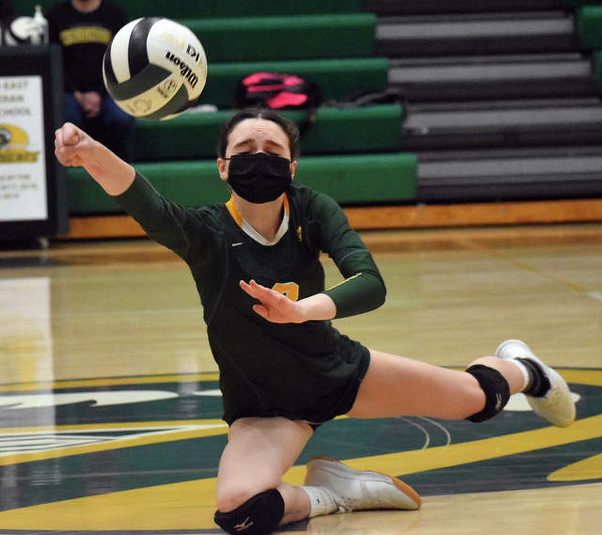 Metro-East Lutheran's Sophia Bold makes a diving attempt for a dig in the second game against Granite City on Tuesday in Edwardsville.