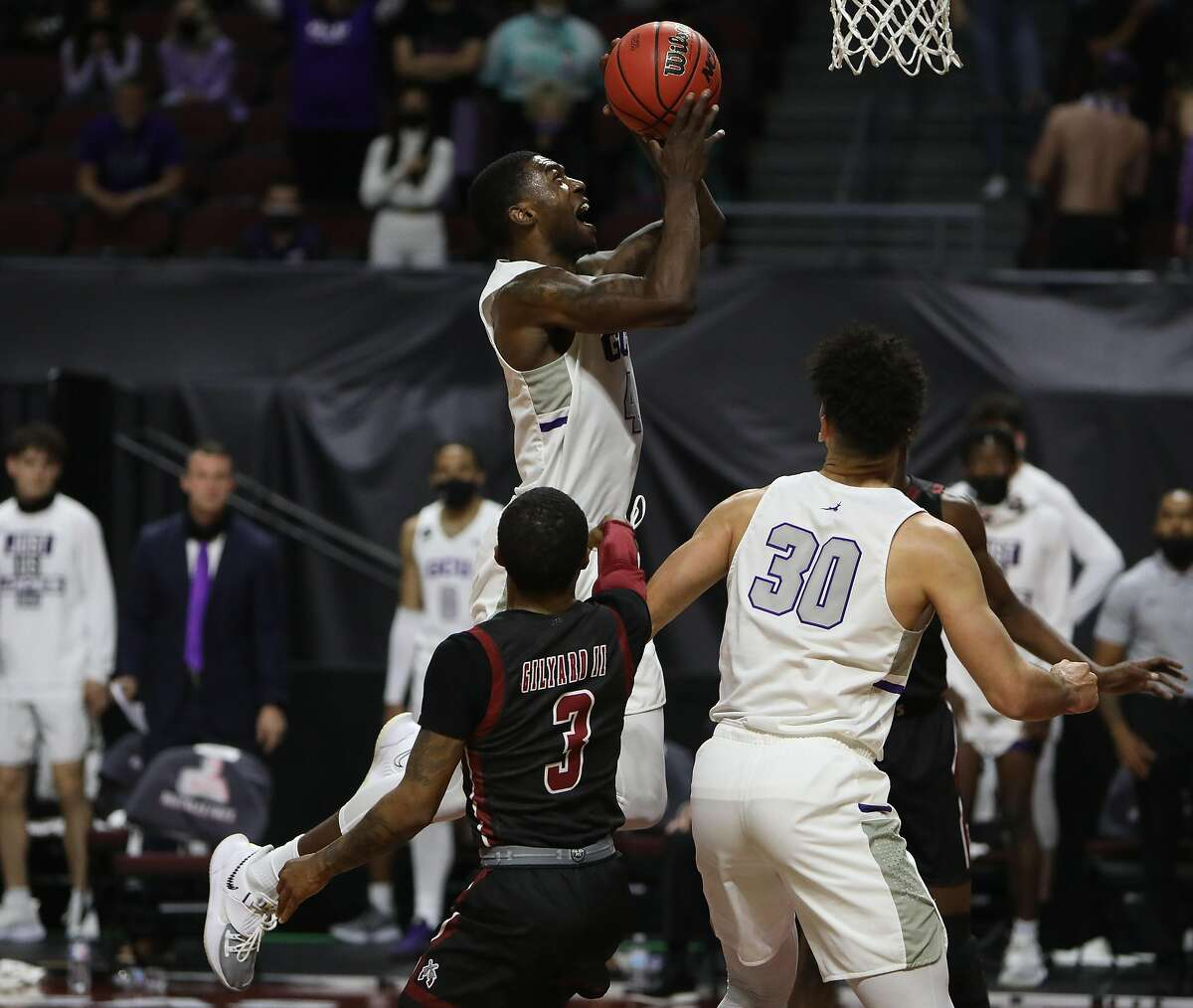 LAS VEGAS, NEVADA - MARCH 13: Oscar Frayer #4 of the Grand Canyon Lopes goes to the rim against the New Mexico State Aggies during the championship game of the Western Athletic Conference basketball tournament at the Orleans Arena on March 13, 2021 in Las Vegas, Nevada. The Lopes defeated the Aggies 74-56. (Photo by Joe Buglewicz/Getty Images)