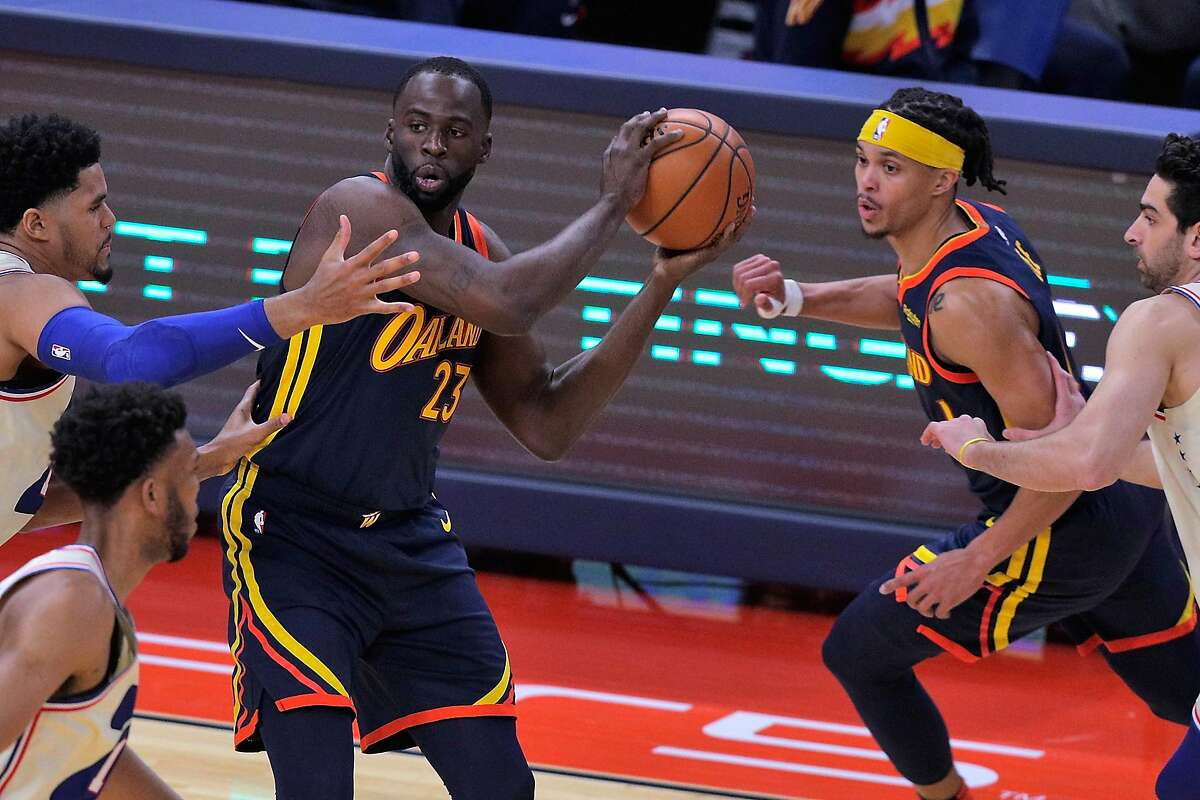 Draymond Green (23) looks to pass in the first half as the Golden State Warriors played the Philadelphia 76ers at Chase Center in San Francisco, Calif., on Tuesday, March 23, 2021.