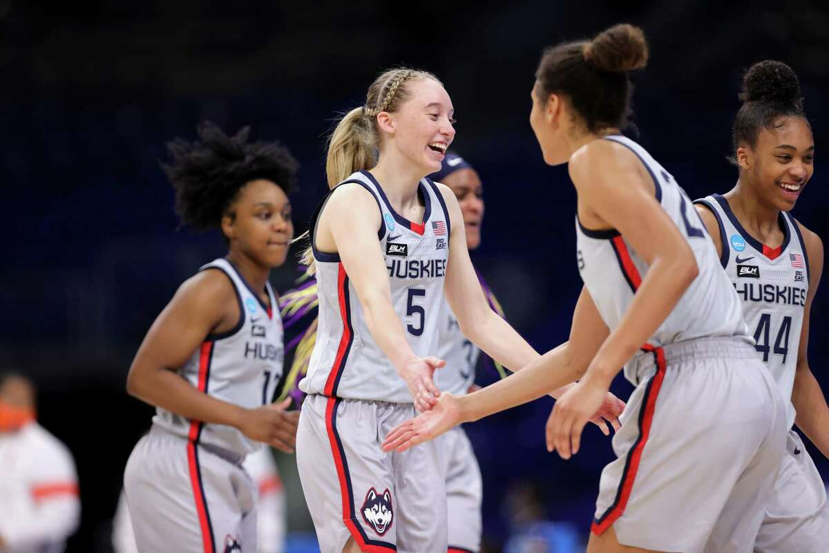 SAN ANTONIO, TEXAS - MARCH 23: Paige Bueckers #5 of the UConn Huskies reacts with Evina Westbrook #22 against the Syracuse Orange during the second half in the second round game of the 2021 NCAA Women's Basketball Tournament at the Alamodome on March 23, 2021 in San Antonio, Texas. (Photo by Carmen Mandato/Getty Images)