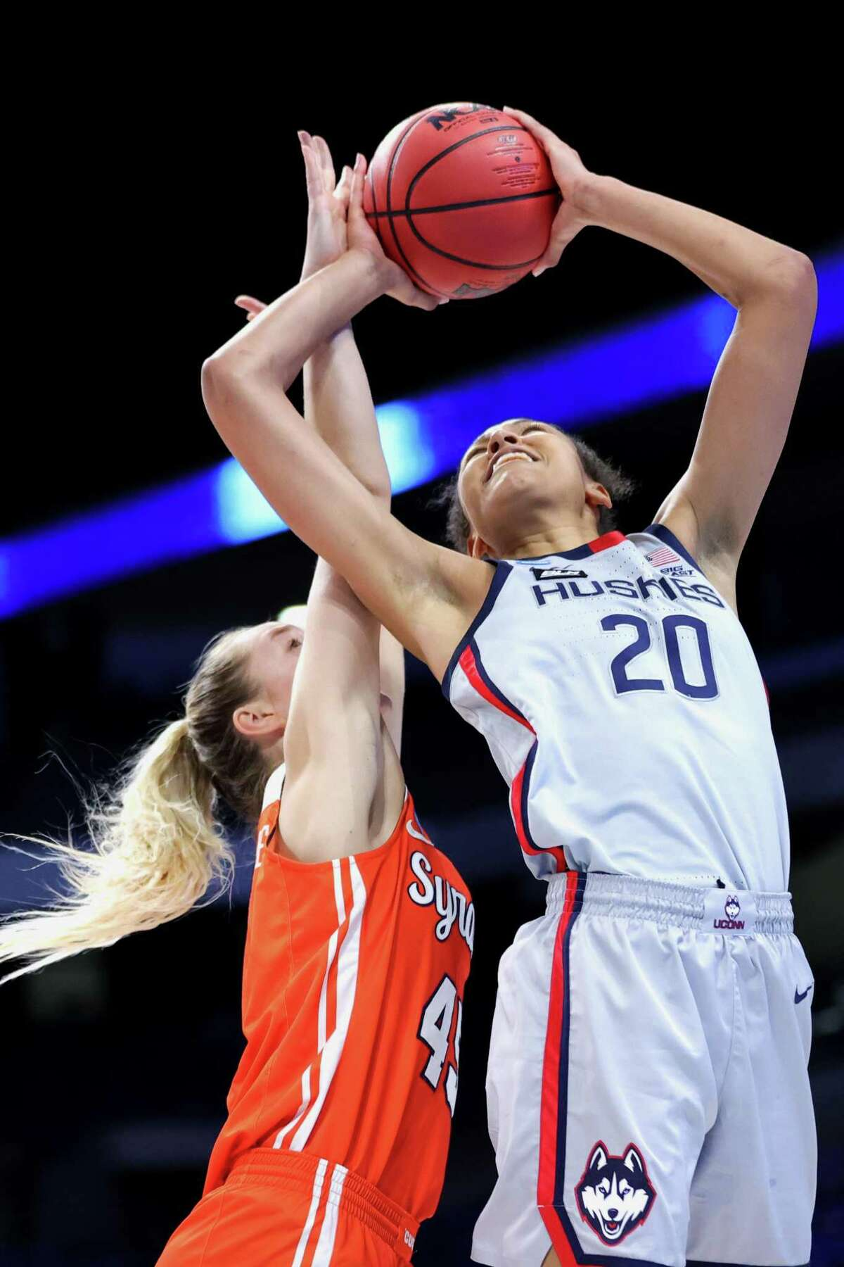 SAN ANTONIO, TEXAS - MARCH 23: Olivia Nelson-Ododa #20 of the UConn Huskies goes up for a basket against Digna Strautmane #45 of the Syracuse Orange during the second half in the second round game of the 2021 NCAA Women's Basketball Tournament at the Alamodome on March 23, 2021 in San Antonio, Texas. (Photo by Carmen Mandato/Getty Images)