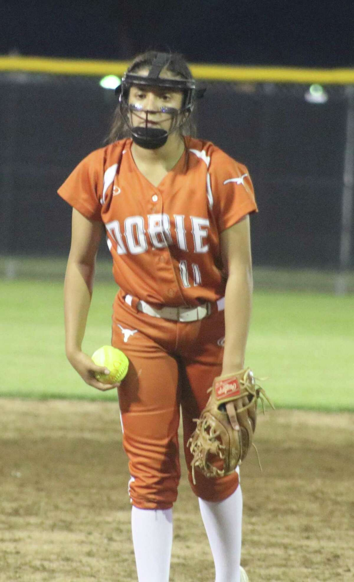 Winning pitcher Marissa Perla gets ready to work on the next Memorial batter as Tuesday night's big game swung towards its conclusion.