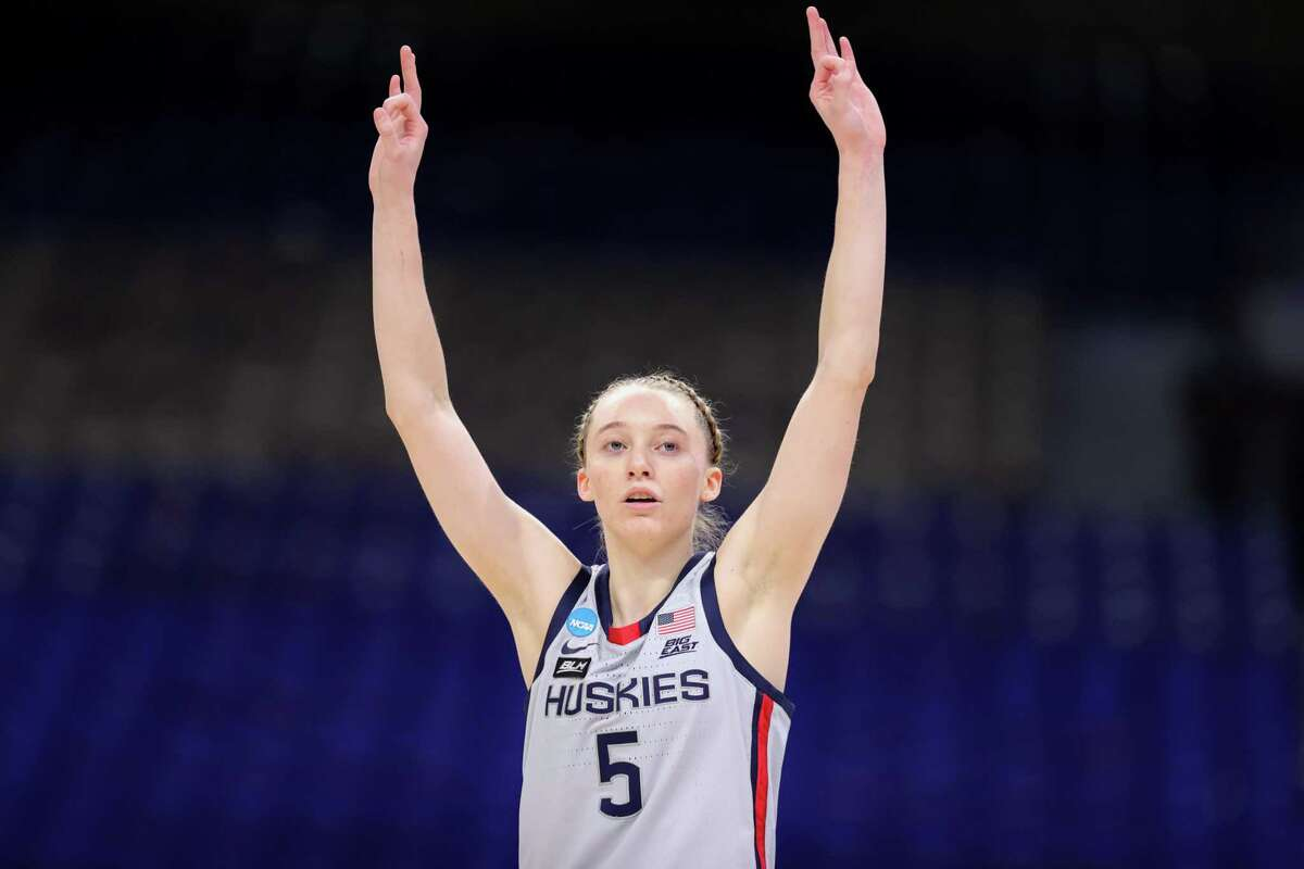 SAN ANTONIO, TEXAS - MARCH 23: Paige Bueckers #5 of the UConn Huskies reacts to a basket against the Syracuse Orange during the second half in the second round game of the 2021 NCAA Women's Basketball Tournament at the Alamodome on March 23, 2021 in San Antonio, Texas. (Photo by Carmen Mandato/Getty Images)