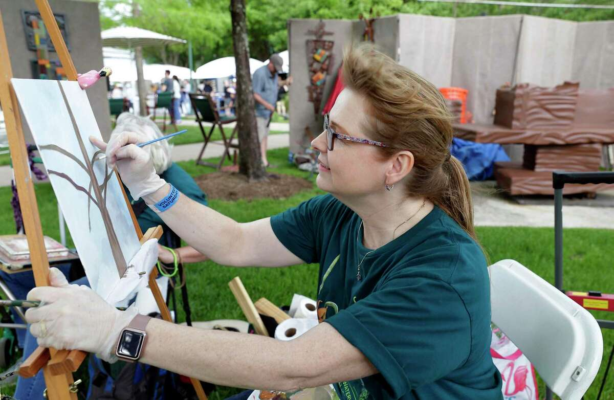 The 2021 version of The Waterway Arts Festival is slated for April 10-11, with the popular Art Dash night of whimsy on Friday, April 9. Here in this archive image, Nora Rule Barber works on a painting amid other artists booths during The Woodlands Waterway Arts Festival Saturday, Apr. 13, 2019 in The Woodlands, TX.