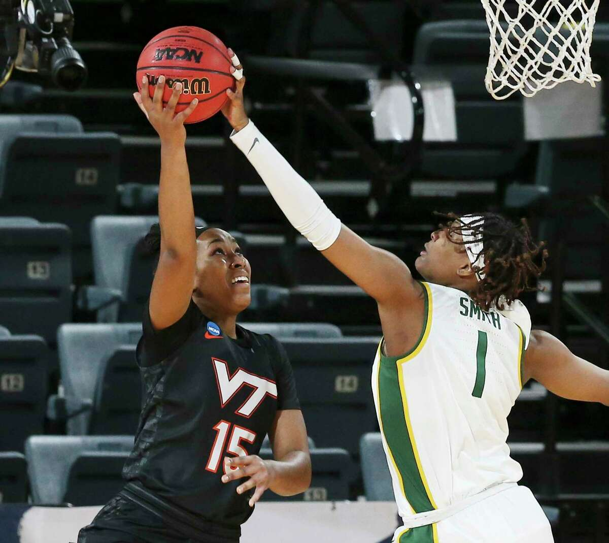Baylor's NaLyssa Smith (01) blocks a shot by Virginia Tech's Azana Baines (15) in the second round of the 2021 NCAA Div. I Women's Basketball Championship at Greehey Arena on Tuesday, Mar. 23, 2021.