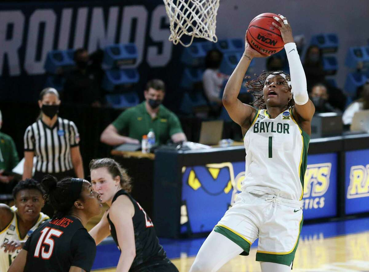 Baylor's NaLyssa Smith (01) attempts a shot against Virginia Tech's Azana Baines (15) in the second round of the 2021 NCAA Div. I Women's Basketball Championship at Greehey Arena on Tuesday, Mar. 23, 2021.