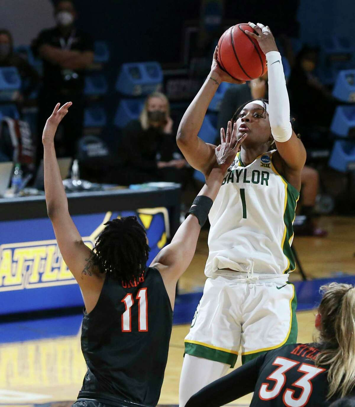 Baylor's NaLyssa Smith (01) scores against Virginia Tech's D'asia Gregg (11) in the second round of the 2021 NCAA Div. I Women's Basketball Championship at Greehey Arena on Tuesday, Mar. 23, 2021.