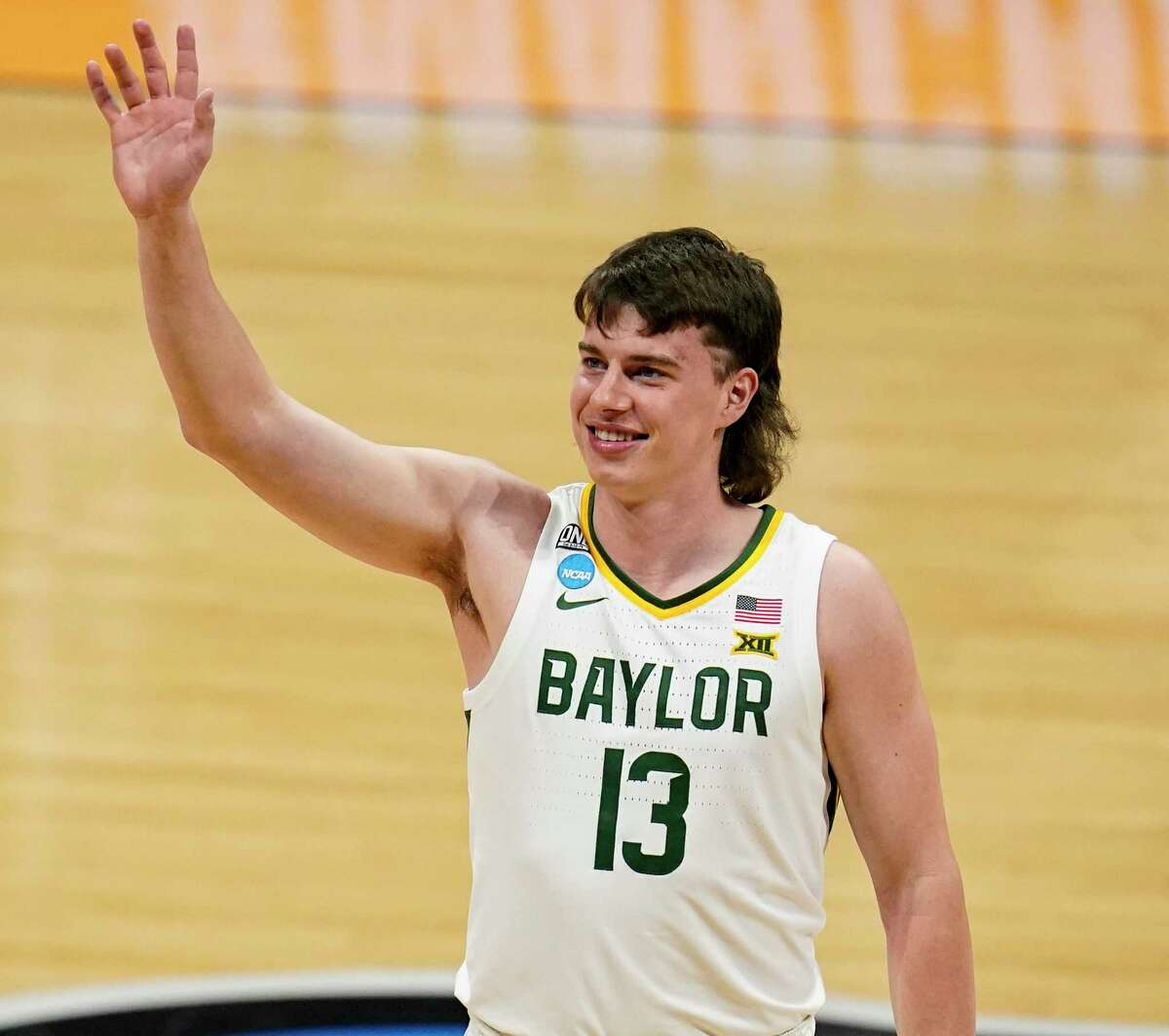 Baylor guard Jackson Moffatt (13) celebrates after a 76-63 win over Wisconsin in a second-round game in the NCAA men's college basketball tournament at Hinkle Fieldhouse in Indianapolis, Sunday, March 21, 2021. (AP Photo/Michael Conroy)