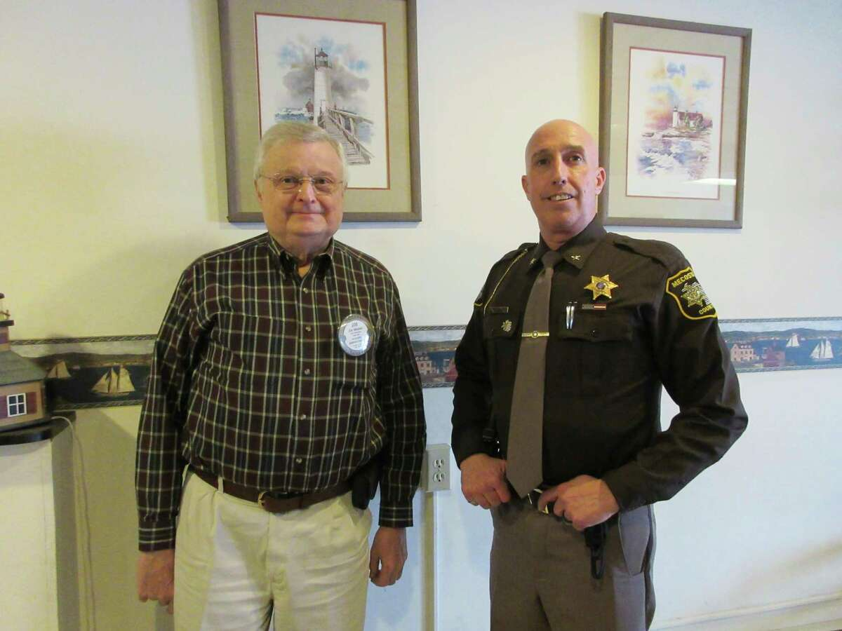 Mecosta County Sheriff Brian Miller recently spoke to the Rotary Club of Big Rapids. Sheriff Miller's presentation centered on his history as an area resident, plus his continued quest to make Mecosta County a better and safer place to live and raise children. Sheriff Miller is pictured with Club President Jim Woolen. The Rotary Club of Big Rapids meets Tuesdays at noon at Wild Rose Café. To learn more, visit www.bigrapidsrotary.org. (Submitted photo)