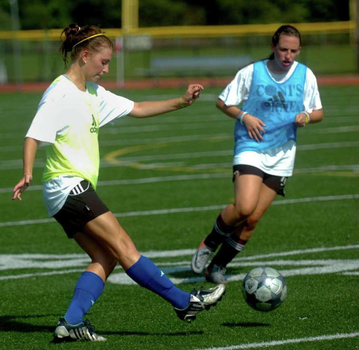 St. Joseph's Katie Dannaher, left, practices on the school's field Thursday, September 2, 2010.