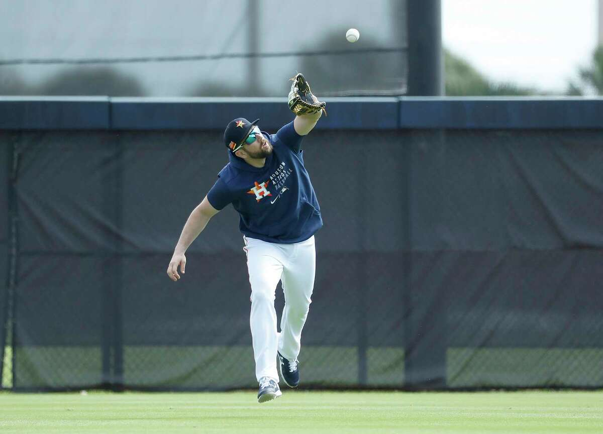 Houston Astros outfielder Steven Souza Jr. (20) catches a ball during the second day of full-squad workouts for the Astros at Ballpark of the Palm Beaches in West Palm Beach, Florida, Tuesday, February 23, 2021.