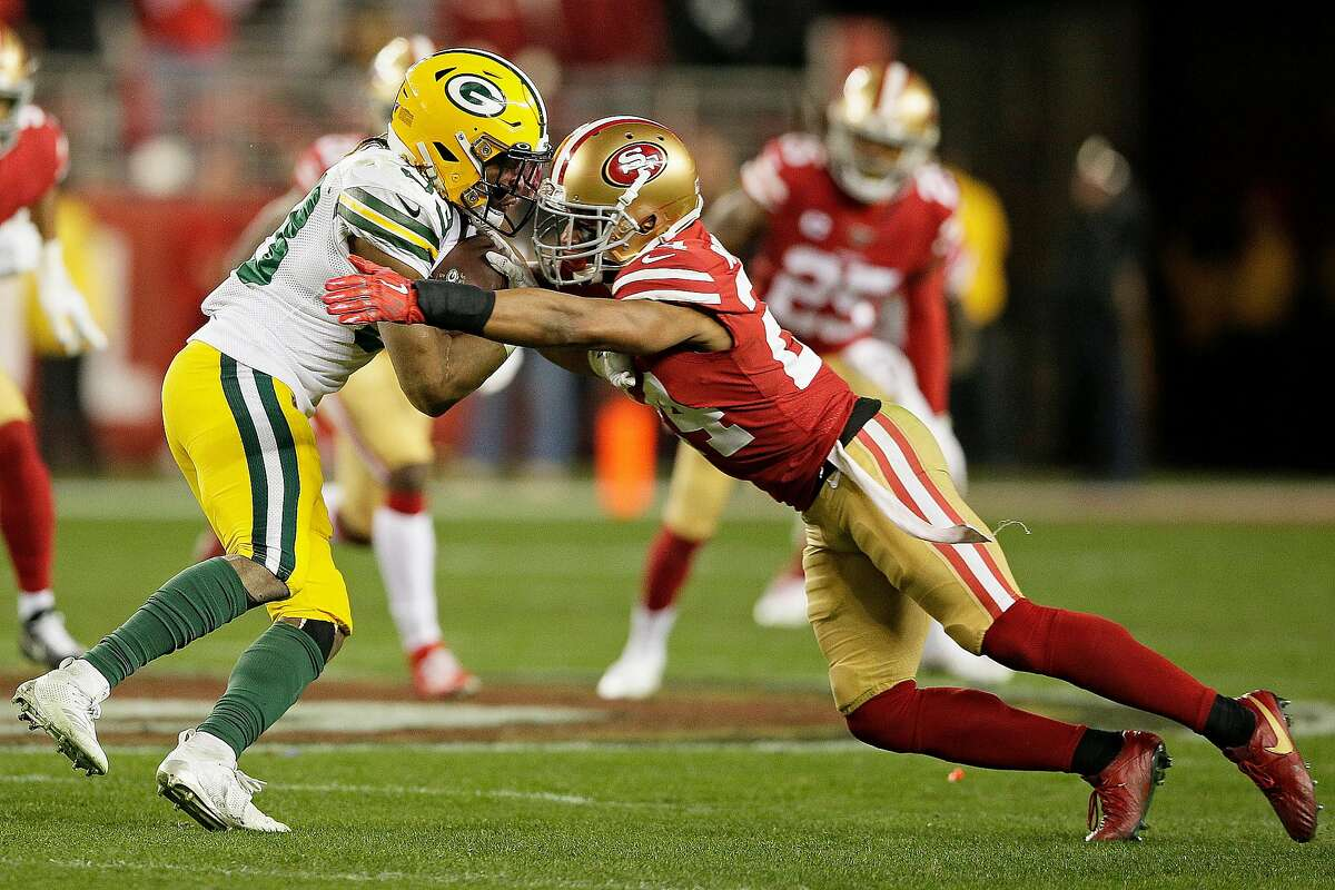 San Francisco 49ers defensive back K'Waun Williams (24) tackles Green Bay Packers running back Aaron Jones (33) in the NFC Championship Game at Levi's Stadium, Sunday, Jan. 19, 2020, in San Francisco, Calif. The San Francisco 49ers won 37-20 against the Green Bay Packers. The 49ers will play the Kansas City Chiefs in the Super Bowl.