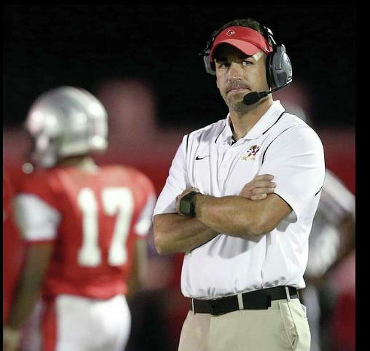Alton High School head football coach Eric Dickerson's team will forfeit Friday's scheduled game because of a lack of available varsity players. He is shown during a previous season.