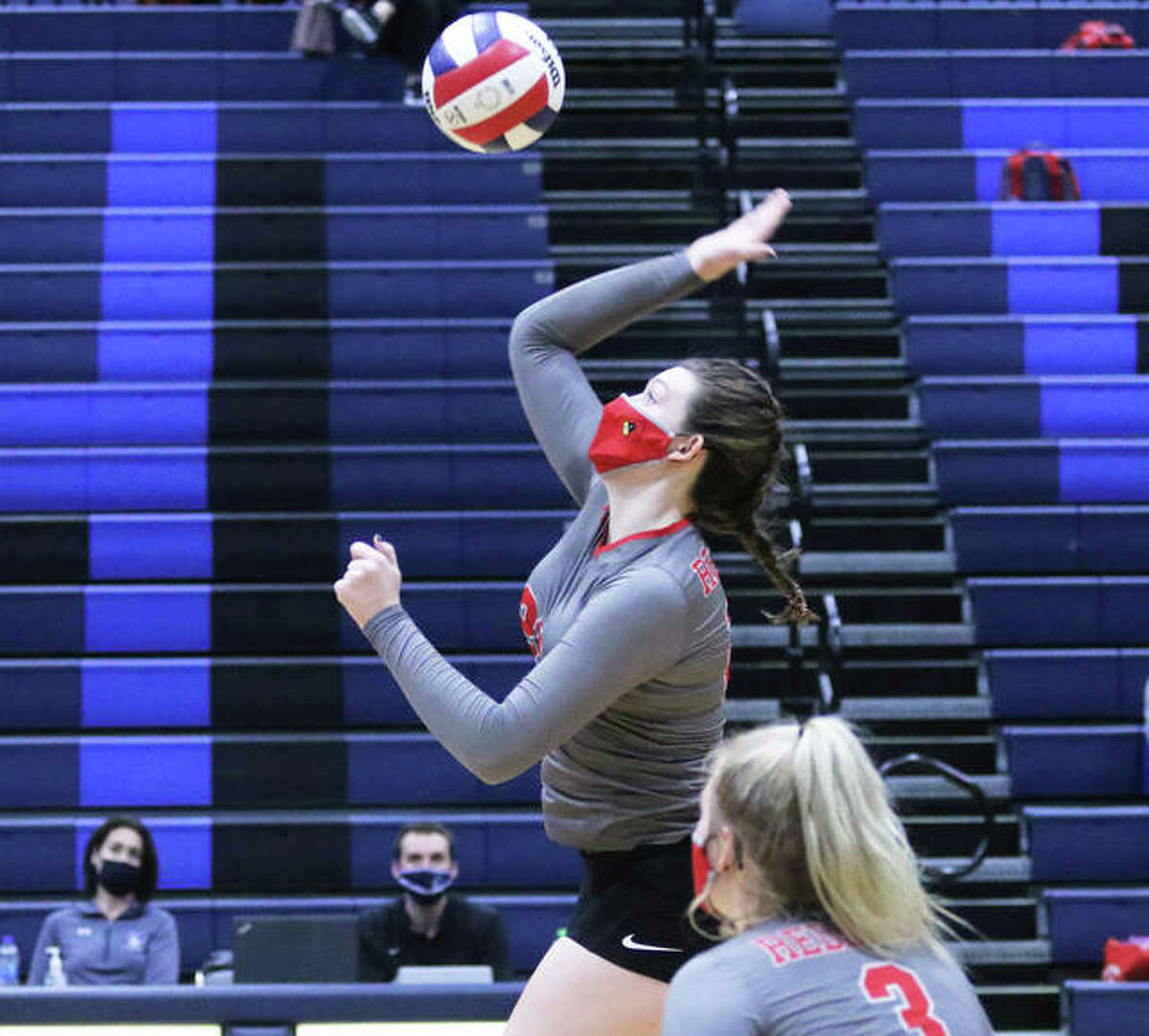 Alton's Brooke Wolff, shown on the attack in a SWC match at Belleville East on March 16, had 16 kills and six blocks on Tuesday night to help the Redbirds end an 18-match SWC losing streak with a three-set win at East St. Louis.